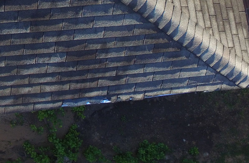 Photo of damaged roof shingles captured by drone technology