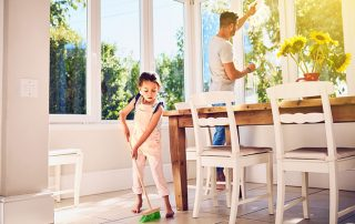 Image of girl and father cleaning their home for article by a Houston home inspector on doing Spring Cleaning in January